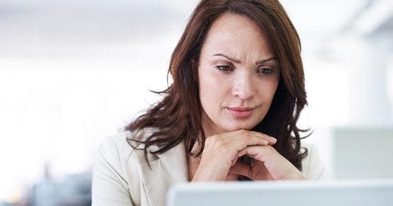 Woman looking at her screen © iStock
