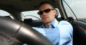 Man driving his car © iStock