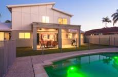 Large pool in backyard of modern home © iStock