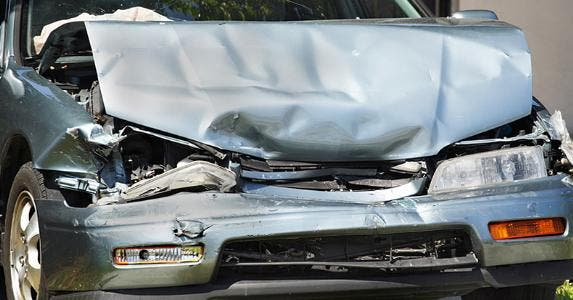 Crushed front hood of car © iStock