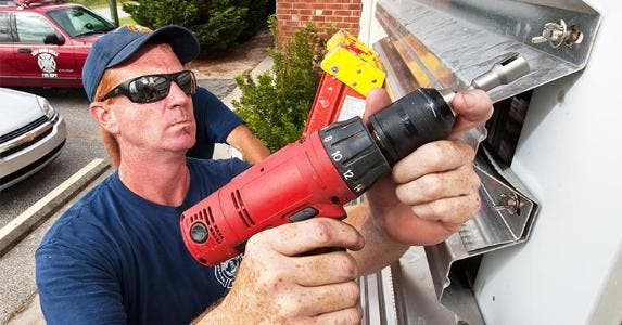 Installing hurricane shutters   PAUL J. RICHARDS/Getty Images