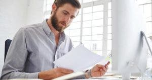 Young man at office | iStock.com/gradyreese