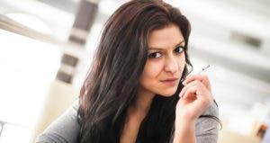 Woman smoking cigarette © iStock