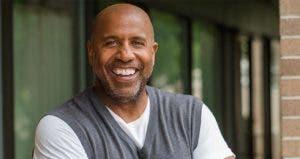 Smiling mature man wearing grey vest © pixelheadphoto digitalskillet/Shutterstock.com