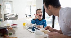Father having breakfast with his young son