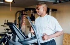Veteran man running on treadmill inside garage