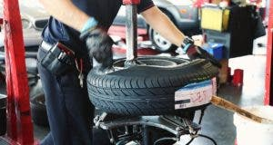 Tire being placed on rim