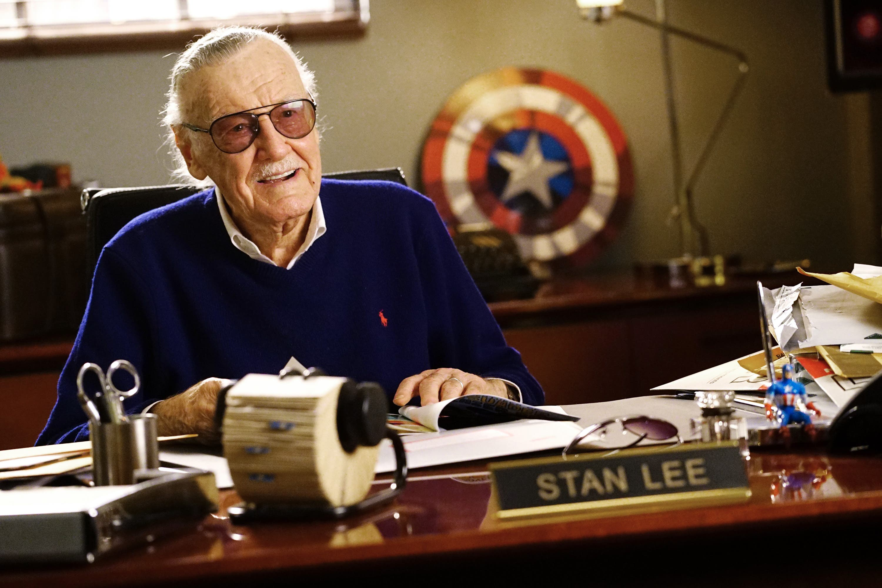 Cartoonist Stan Lee at his desk