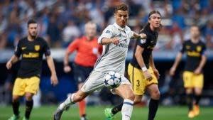 Cristiano ronaldo kicks a football