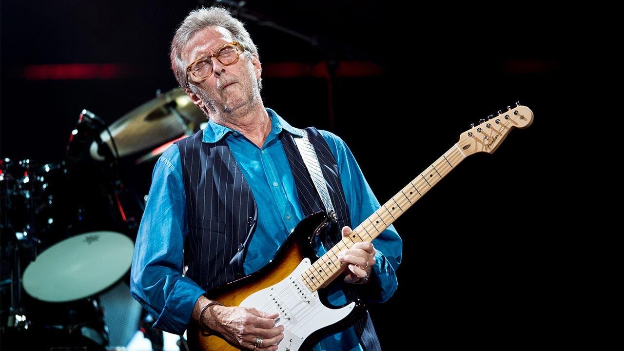 Eric Clapton plays guitar