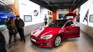 Shoppers eyeing Tesla in showroom