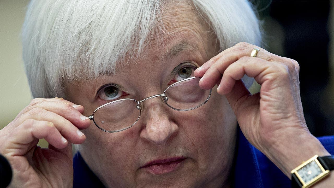 Janet Yellen peering over her glasses