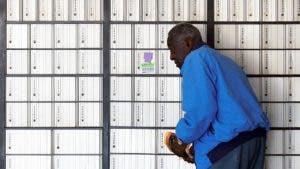 Postal customer looking for his P.O. box