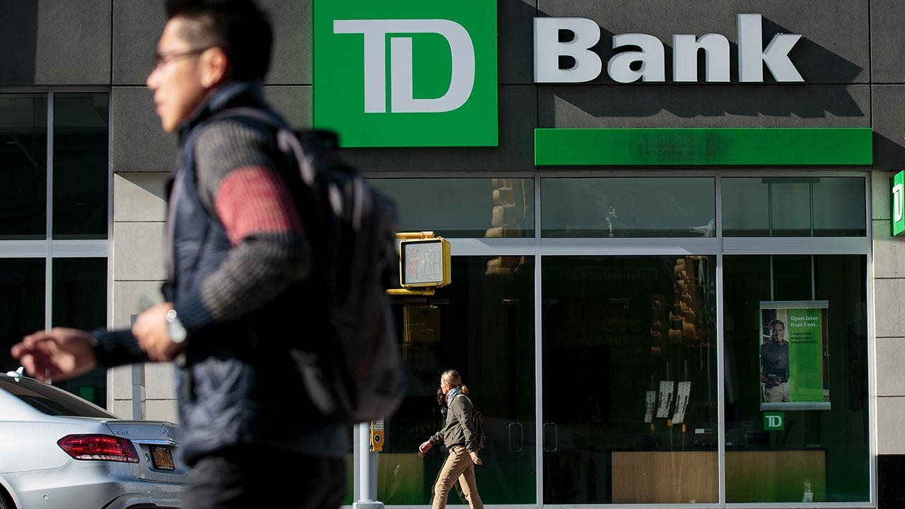 Man walks in front of TD Bank