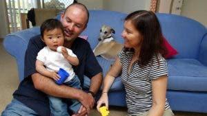 Adoptive parents and child