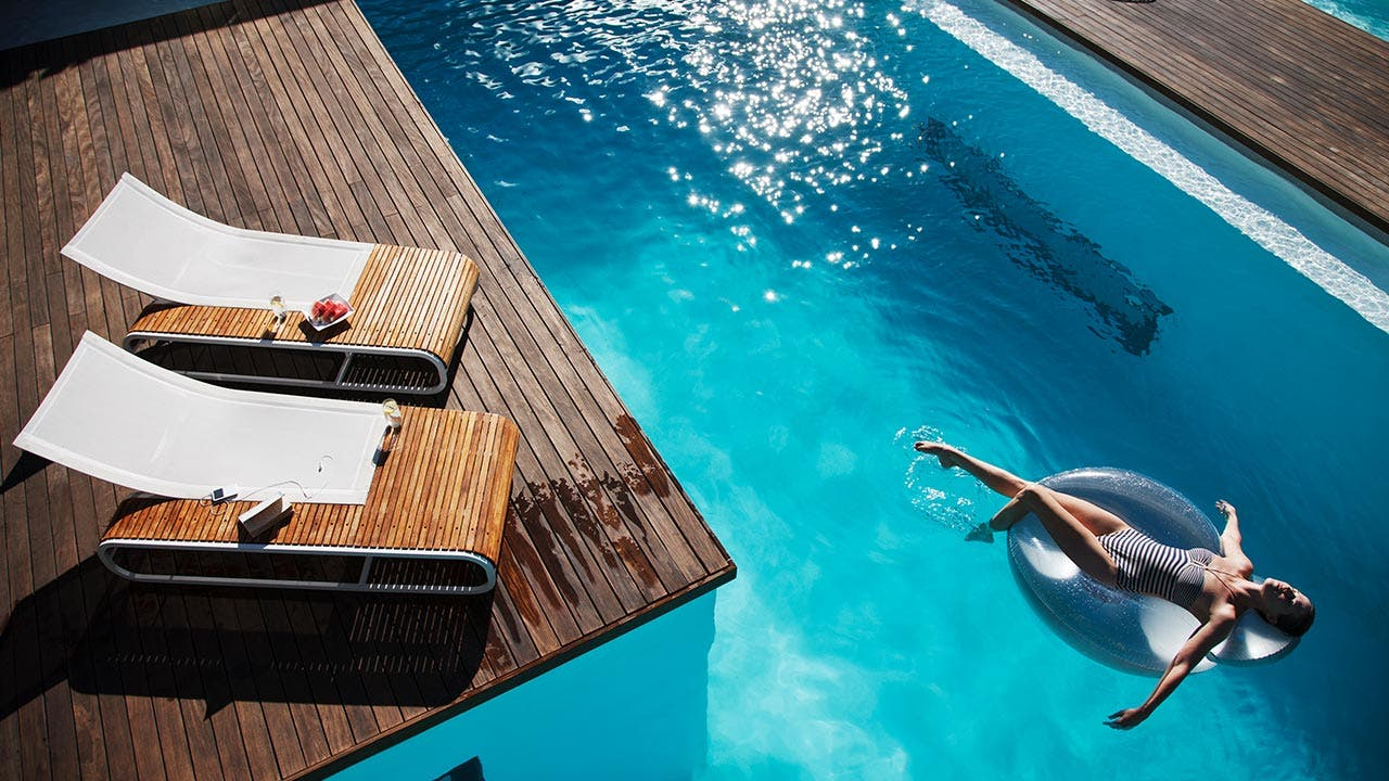 Woman lounging in a modern pool