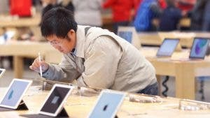 Man looking at iPads in an Apple store