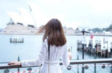 Woman looking at the Sydney Opera House