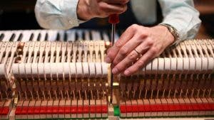 A piano tuner at work