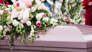 Casket covered in flowers