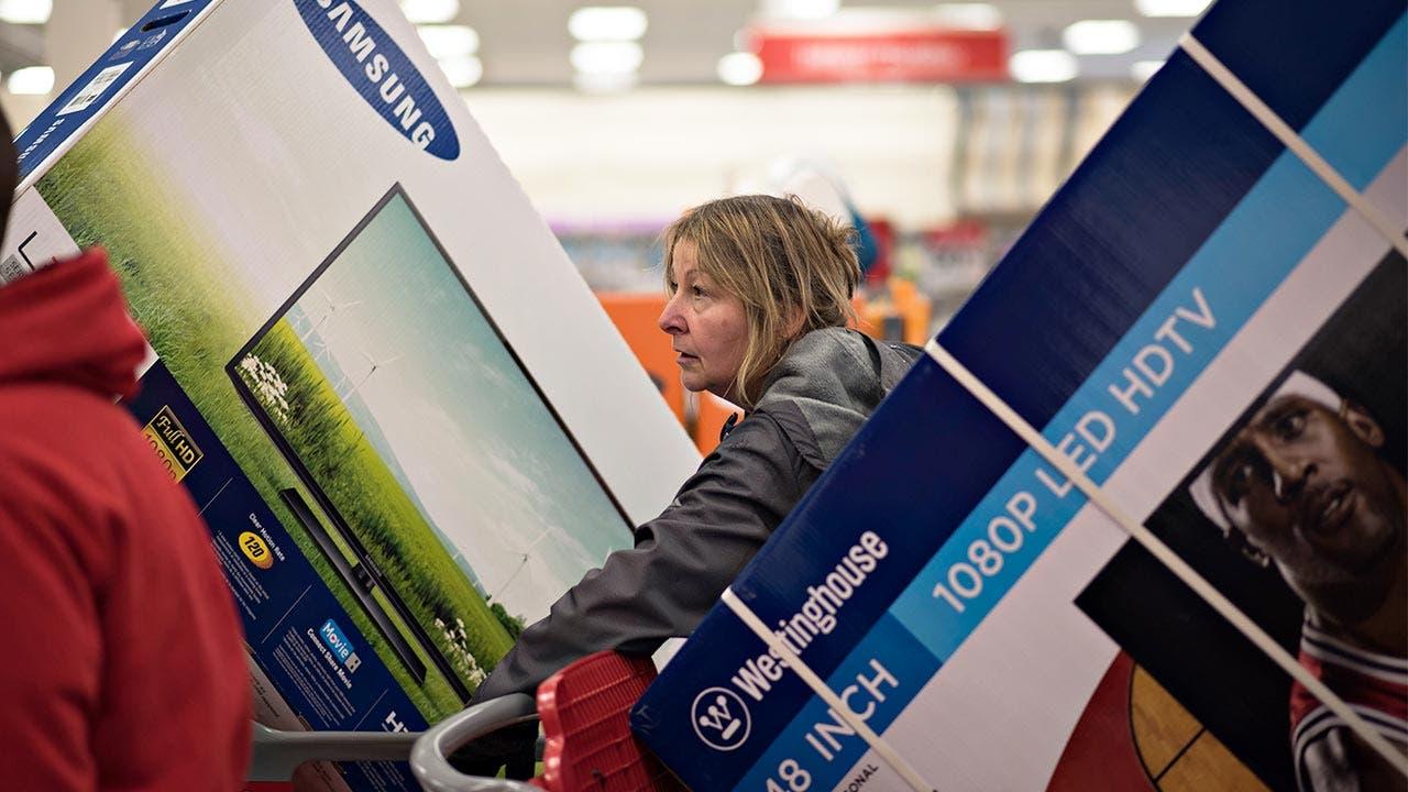 Woman buying HDTVs