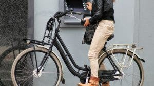 Woman at atm on bike