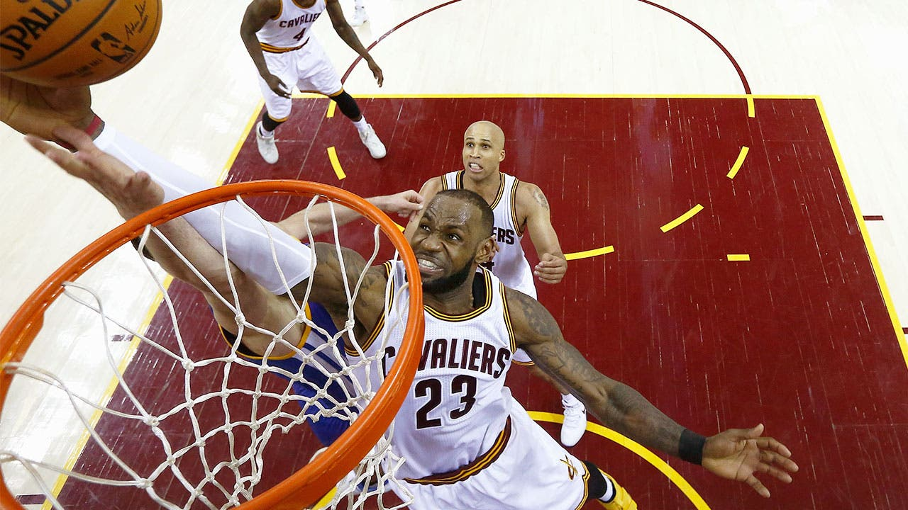 LeBron James grabbing a rebound