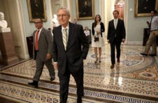 Senate Majority Leader Mitch McConnell walking to health care meeting