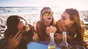 Three women hanging out at the beach