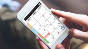 Person looking at calendar app on phone