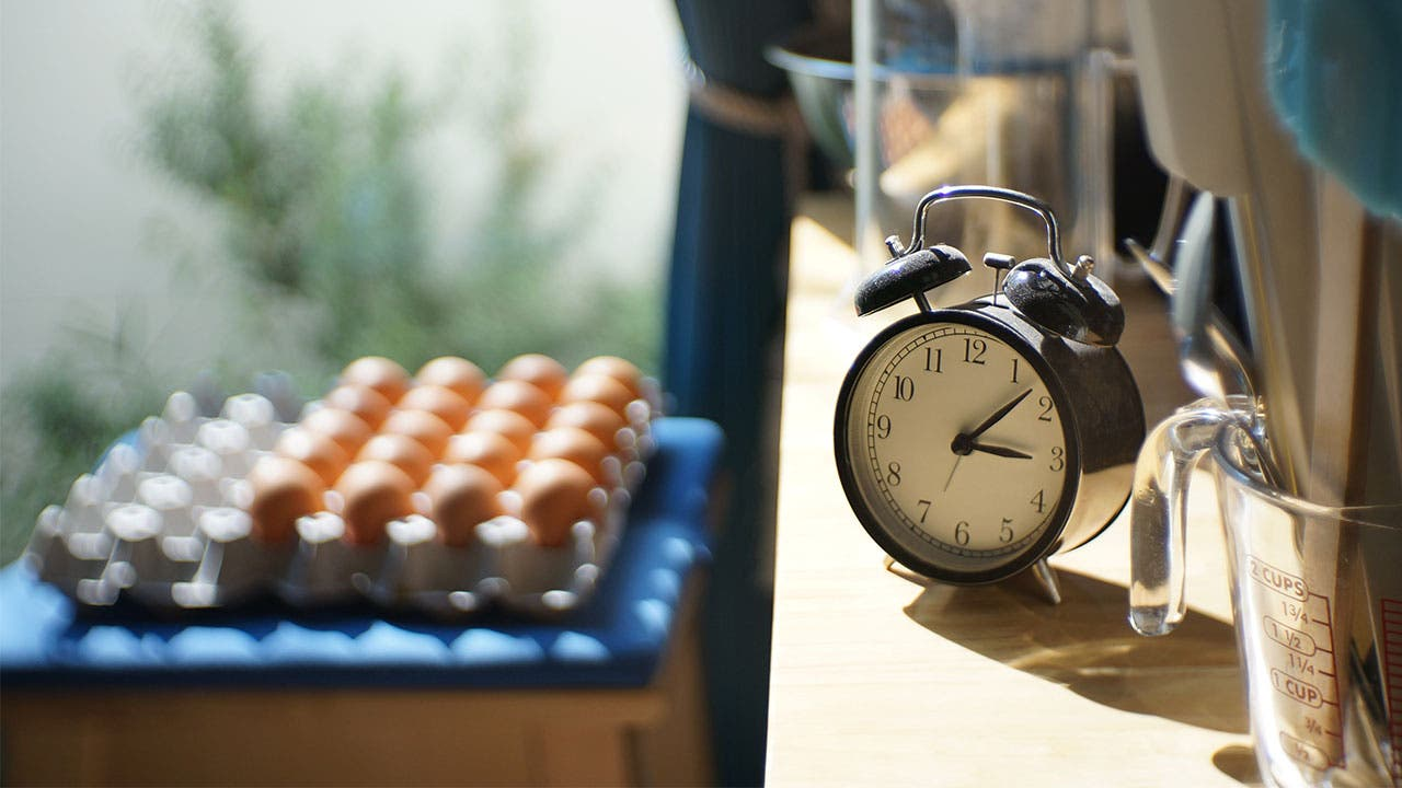 A carton of eggs and a clock