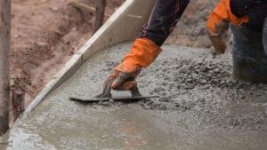 Man leveling concrete