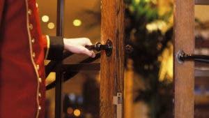 doorman opens door