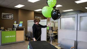 H&R Block tax preparer opens the store for the day
