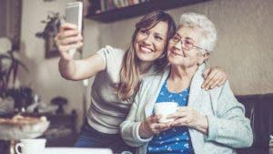 woman taking selfie with older woman
