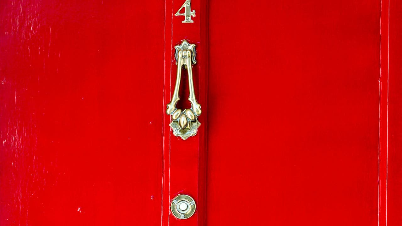 red door knocker and doorbell