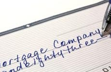 Check written to mortgage company for payment © AR Images - Fotolia.com