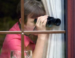 Nosy woman spying on neighbors