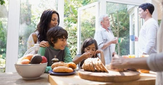 Family gathering for breakfast in the kitchen   Hero Images/Getty Images