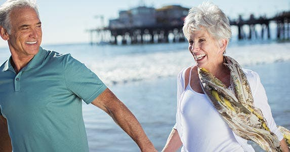 Contribute to your retirement plan | Paul Bradbury/Getty Images