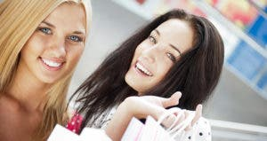 Close up of two young women holding shopping bags © Milles Studio - Fotolia.com