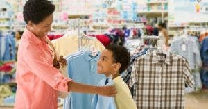 Mom and young son shopping for school clothes | Jose Luis Pelaez Inc/Getty Images