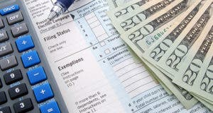 Form 1040 focused on exemptions section and calculator © Kimberly Reinick - Fotolia.com