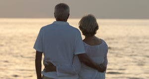 Senior couple watching sunset over horizon © Darren Baker/Shutterstock.com