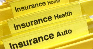 Insurance policies in their own yellow folder © Kellis/Shutterstock.com