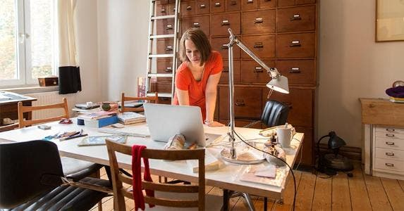 home office. Woman Working In Home Office | Simon Ritzmann/Getty Images
