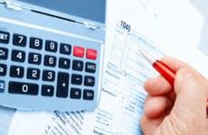 Working on taxes © iStockPhoto.com