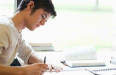 Young man writing at desk © wavebreakmedia/Shutterstock.com