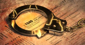 Handcuffs on tax form © PTstock/Shutterstock.com