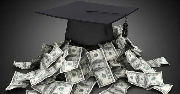 Graduation cap on top of pile of money